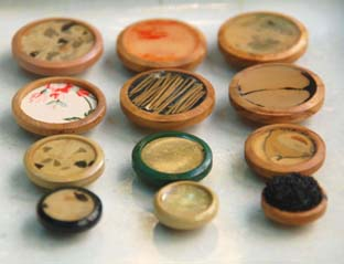 botones de madrea y resina