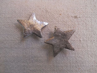 botón metálico estrellas de mar